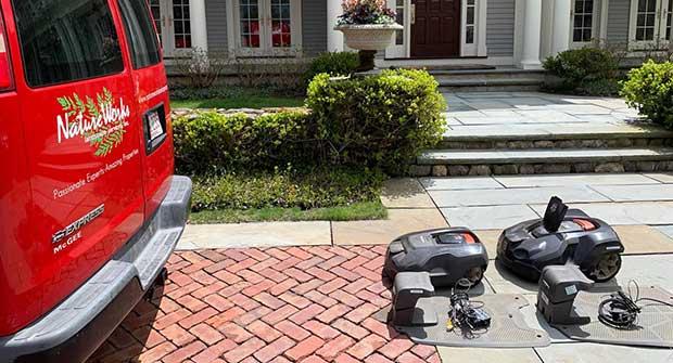 Robotic mowers and NatureWorks van (Photo: NatureWorks)