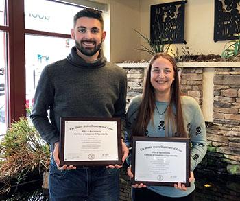 Zachary Pulcini and Megan Wolfgang of Eichenlaub show off apprenticeship certificates. (Photo: Eichenlaub)