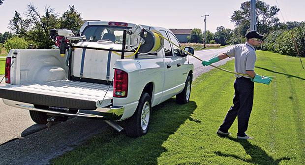 Man operating spray rig (Photo: Hannay Reels)