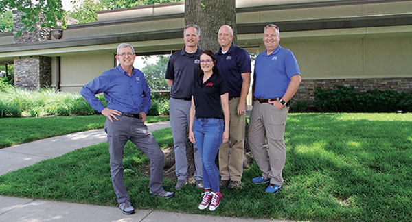 """The culture is one of a kind,"""" says Katherine Miller (pictured center), customer service manager. """"(It's) about the people; they have the heart."""" From left to right: Larry Ryan, Roy Heinbach, Miller, Mark Stuhlsatz and Rodney St. John, Ph.D. (Photo: LM Staff)"""
