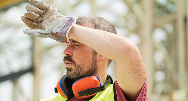 Landscaper shading eyes during hot day (Photo: JulieanneBirch/iStock / Getty Images Plus/Getty Images)