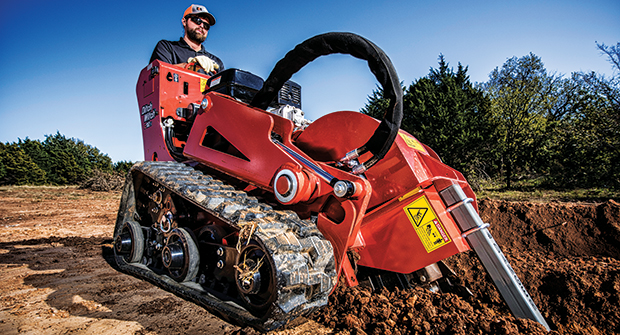 A landscaper uses  Ditch Witch's C12X walk-behind trencher. (Photo courtesy of Ditch Witch)