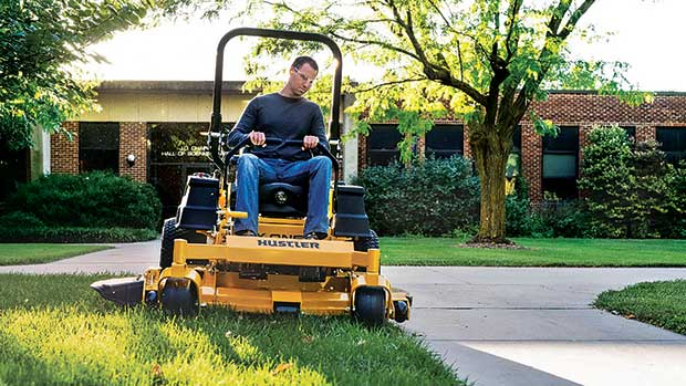 Get it done: Zero-turn mowers can cover a lot of ground and are often used on large complexes. (Photo: Hustler)