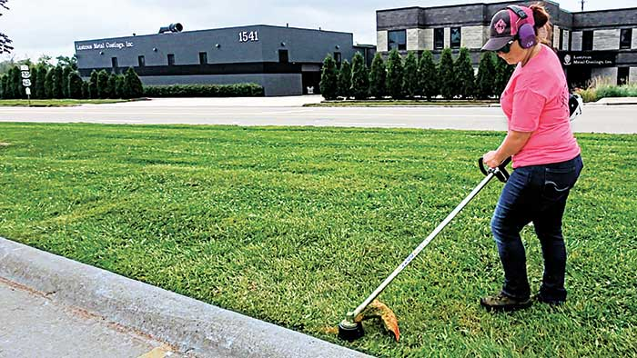 Before purchasing a trimmer, think about operator comfort and how and where the trimmer will be used. (Photo: Spencer's Lawn Care)