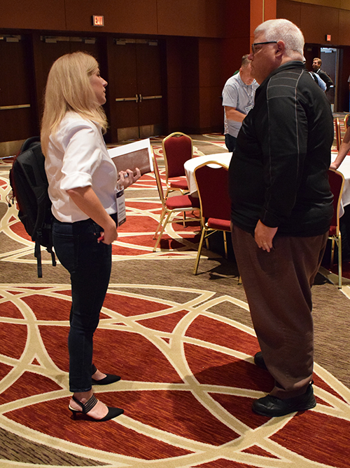 Yellowstone Landscape Director of Business Optimization Christina Franzen talks to Aspire Software Chief Product and Technology Officer Dan Blake (Photo:LM Staff)