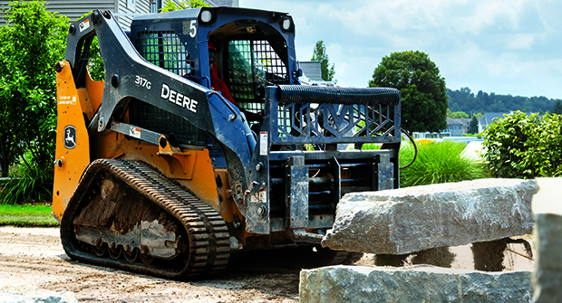 Backyard access: DeHamer Landscaping relies on compact equipment to get into backyards and other tight spaces for jobs such as installing retaining walls (Photo: Marvin Shaouni).