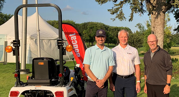 From left: Village Development Director David Newman, Doosan Bobcat President Mike Ballweber, Open Tournament Director Mark Johnson 2021. (Photo courtesy of Bobcat Co.)