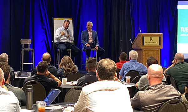 Todd Pugh of Enviroscapes (left) and Jeffrey Scott discuss how companies can adapt to the labor crisis. (Photo: LM Staff)